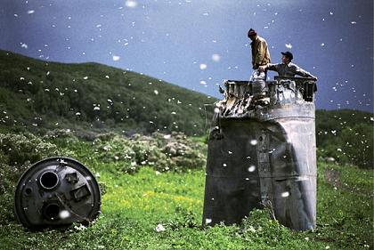 Villagers collecting scrap from a crashed spacecraft. Photographed by Jonas Bendiksen