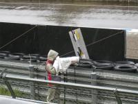 雨のカメラマン