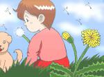 タンポポの綿毛を飛ばす少女