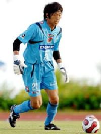 02 Feb 07 - Koji Ezumi basks in the glory of a 1-0 defeat