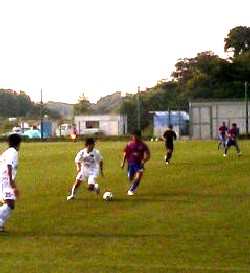 06 Aug 06 - Kota on the ball with Ishigame (left) against Juntendo University