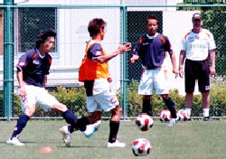 20 May 07 - The briefest glimpse of Takashi Hirano (left) in training
