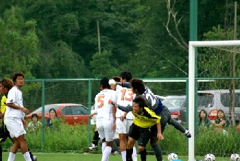 27 Aug 06 - Koji Ezumi, er, dominates a goalmouth scramble