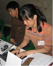 いつも一緒?の立花くん(奥)と藤田さん(手前)。第7回県プロジェクト共同委員会会議にて。