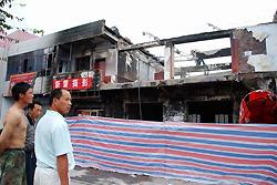 中国:暴動から1カ月