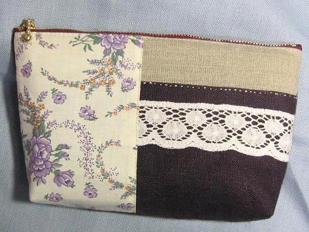 ②紫ポーチ 白い糸のステッチ