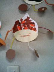 Moyo made chestnut with paper and braids at preschool.