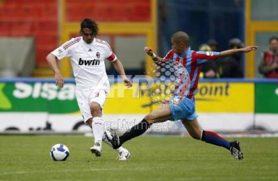 Milan's defender and captain Paolo Maldi  Milan's defender and captain Paolo Maldini (L) fights for the ball with Catania's forward Takayuki Morimoto pf Japan during their Serie A football match at